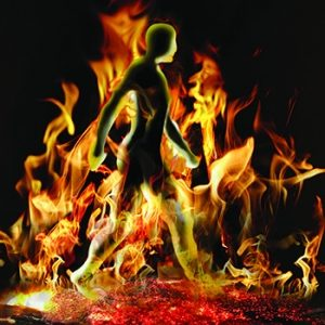 Colorful graphic design of man walking through fire on coals