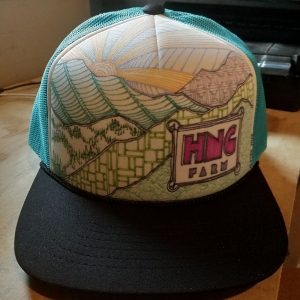 trucker cap with teal mesh back and white foam front, HNG illustration hand-drawn in black and colored pens on front