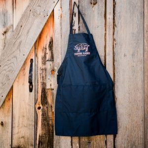 Blue Hickory Nut Gap Farm apron hanging on wooden farm store door