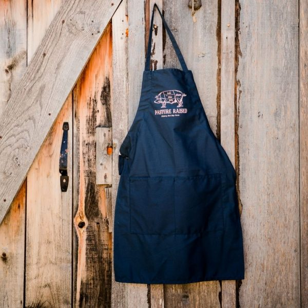 Blue Hickory Nut Gap Farm apron hanging on wooden farm store door